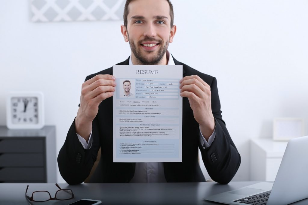 Man showing his resume