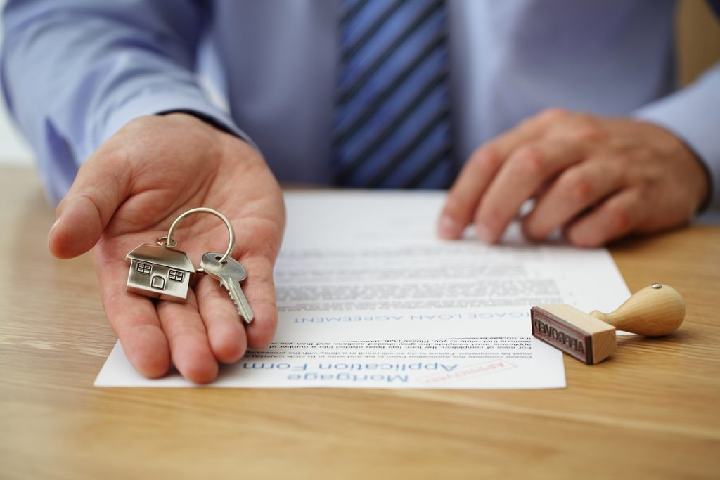 Real estate agent holding house key