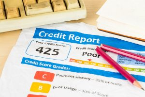 crumpled credit report document