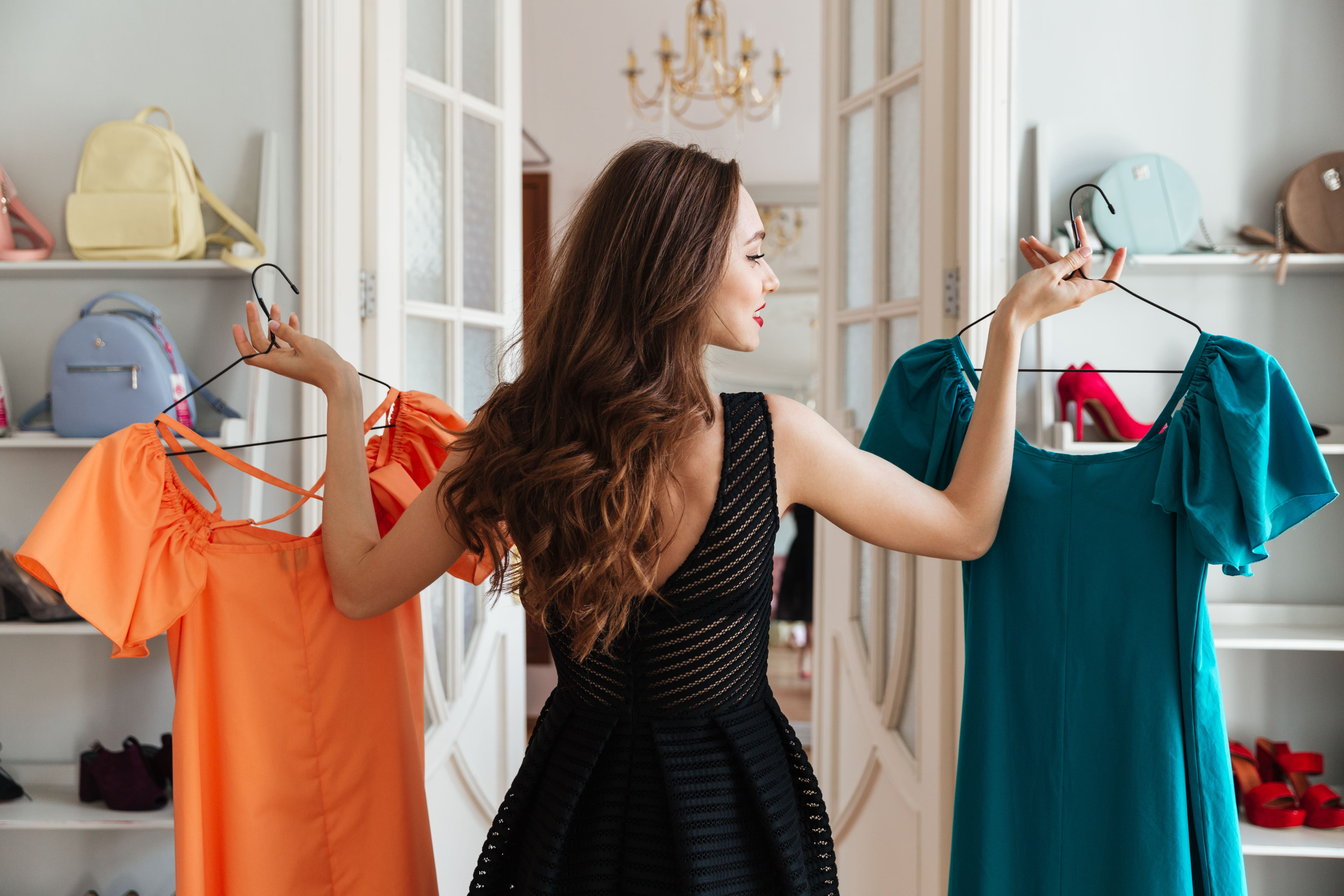 a woman looking at clothes