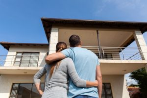 Couple thinking about buying the house