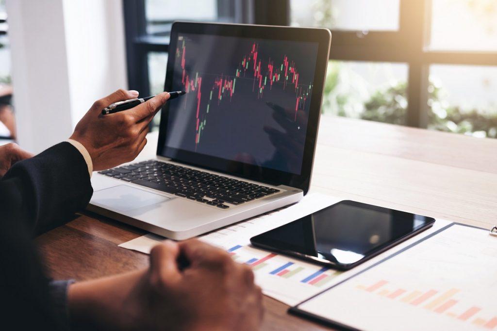 Businessmen checking stock trends