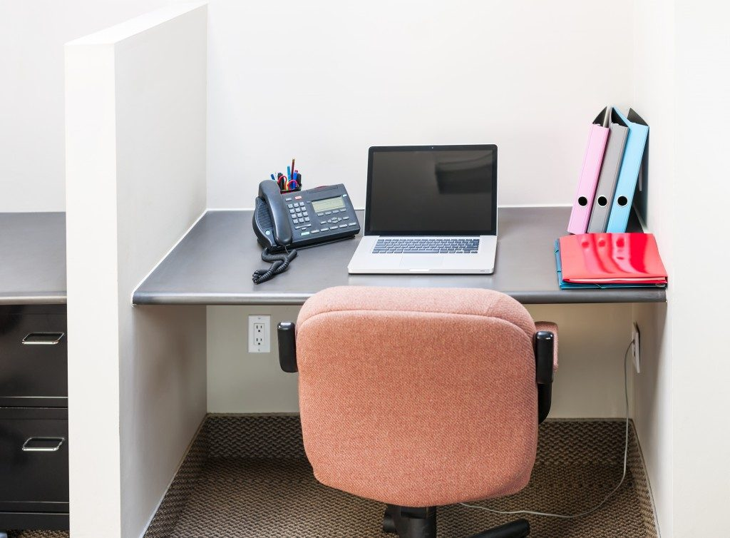 small office cubicle with pink chair