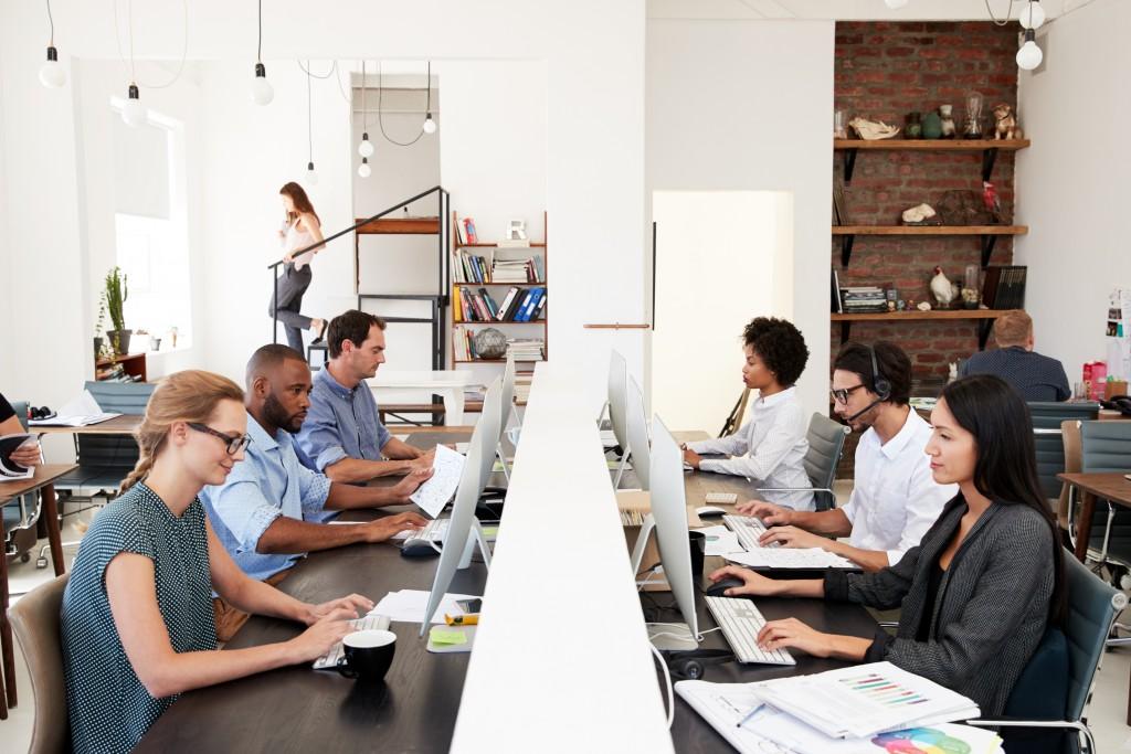 Employees in an open plan office