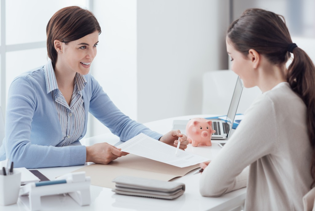 financial consultant talking to a woman