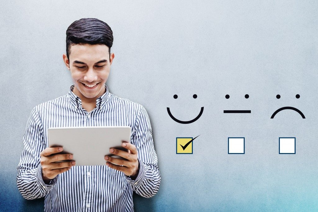 man checking box on satisfaction survey