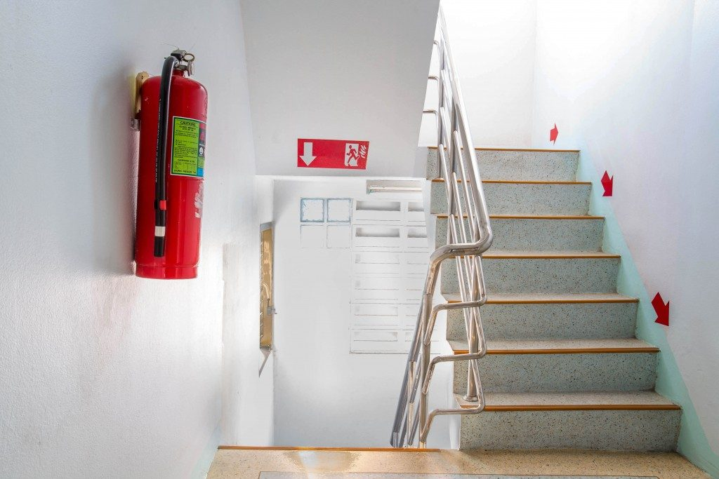 Fire exit with fire extiguisher
