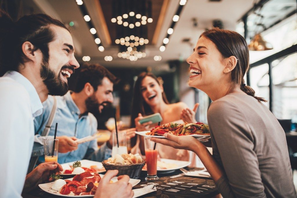 group of frineds dining in a restaurant