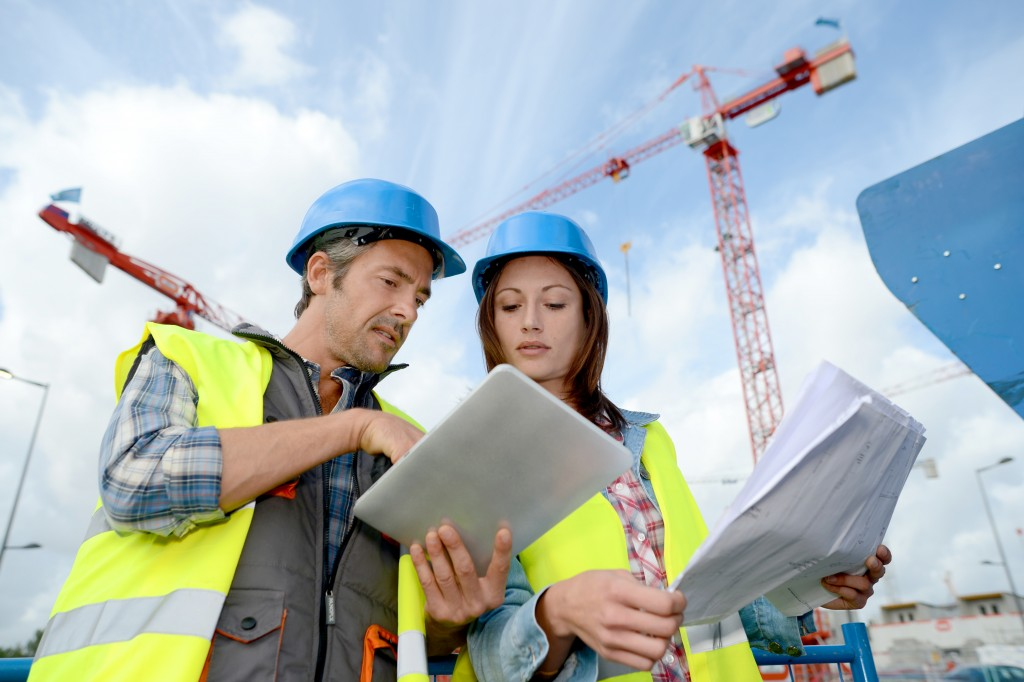 engineers discussing building plans in the construction site