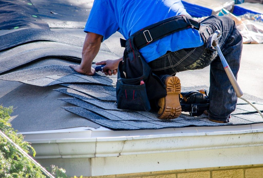 man repairing his roof