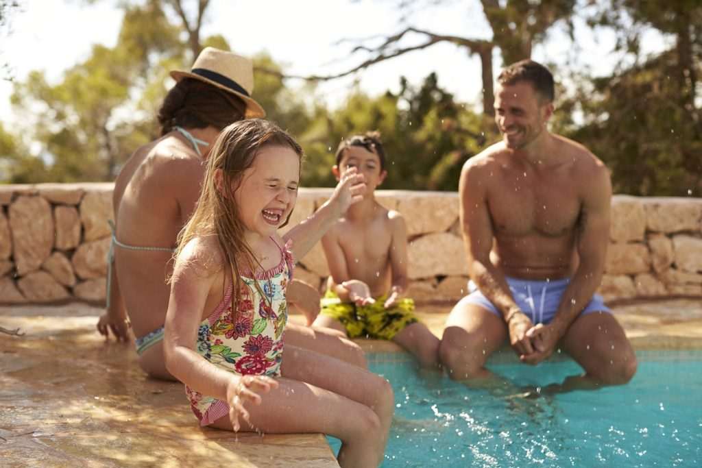 Kid with family enjoying the swimming pool