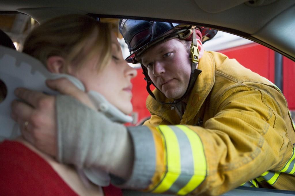 fireman rescuing a woman