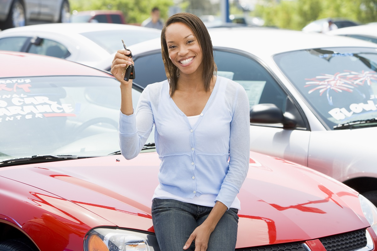Woman holding a car key