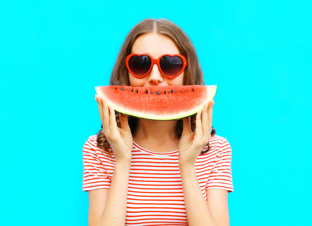 girl with a watermelon slice
